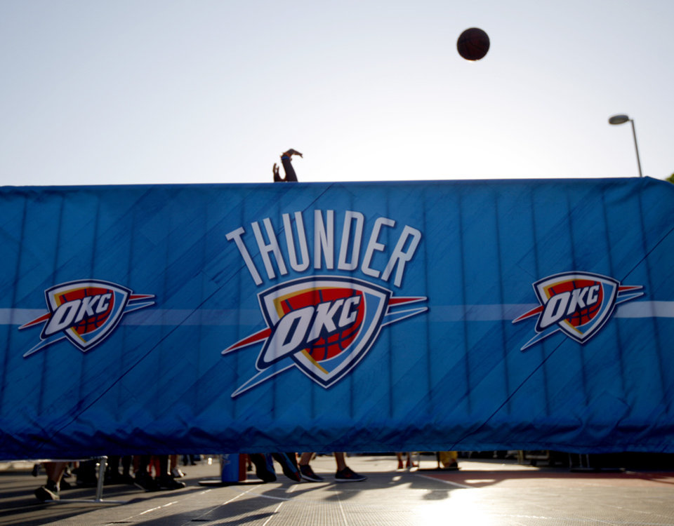 Photo - A fan shoots a basket outside the arena before Game 1 of the Western Conference semifinals in the NBA playoffs between the Oklahoma City Thunder and the Los Angeles Clippers at Chesapeake Energy Arena in Oklahoma City, Monday, May 5, 2014. Photo by Bryan Terry, The Oklahoman