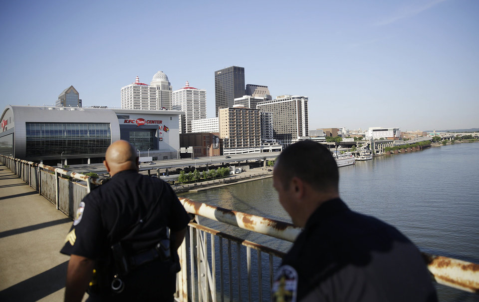 Photo - Police patrol along a bridge before a funeral procession begins for Muhammad Ali Friday, June 10, 2016, in Louisville, Ky. (AP Photo/David Goldman)