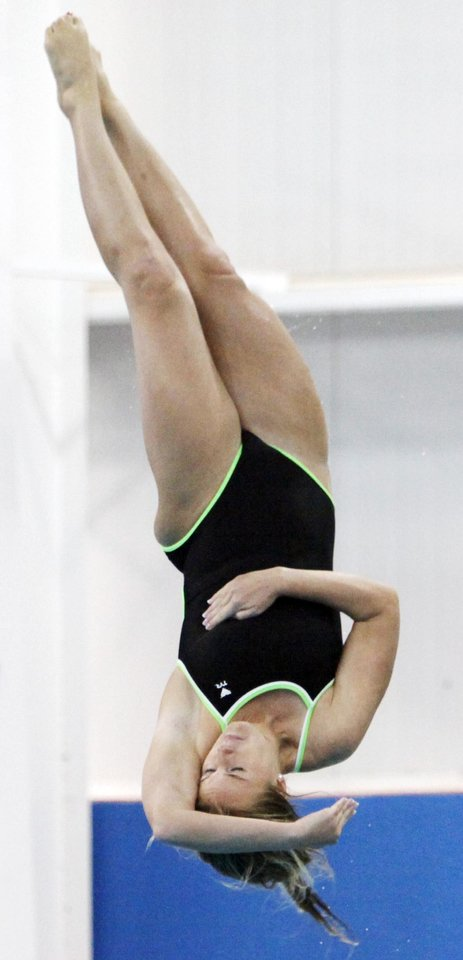 Christine Runkle of Concordia competes in women's 1 meter diving preliminaries during the NAIA Swimming and Diving National Championships at Oklahoma City Community College in Oklahoma City, Wednesday, Feb. 29, 2012. . Photo by Nate Billings, The Oklahoman