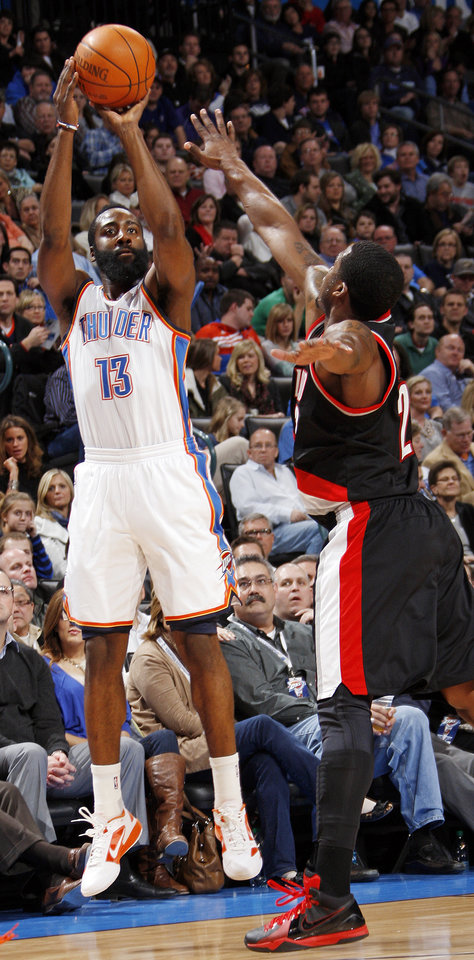 Oklahoma City\'s James Harden (13) takes a shot over Marcus Camby (23) of Portland in the first half during the NBA basketball game between the Oklahoma City Thunder and Portland Trail Blazers at Chesapeake Energy Arena in Oklahoma City, Tuesday, Jan. 3, 2012. Photo by Nate Billings, The Oklahoman