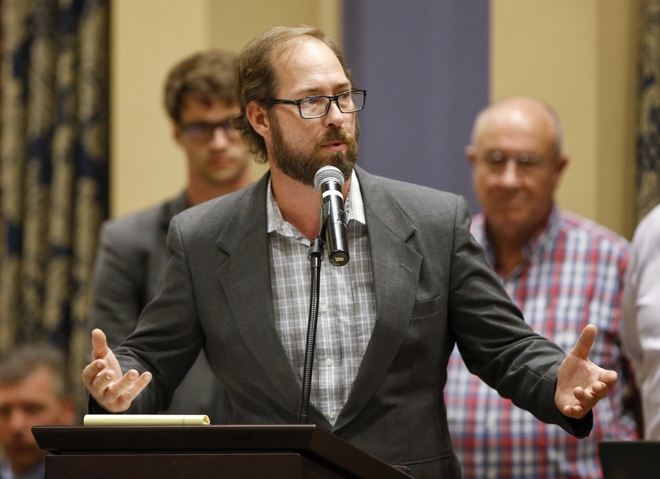 Photo - Shawn Jenkins speaks during a presentation by Oklahomans for Cannabis at the first meeting of the Medical Marijuana Working Group in room 535 of the state Capitol in Oklahoma City, Wednesday, July 25, 2018. Photo by Nate Billings, The Oklahoman