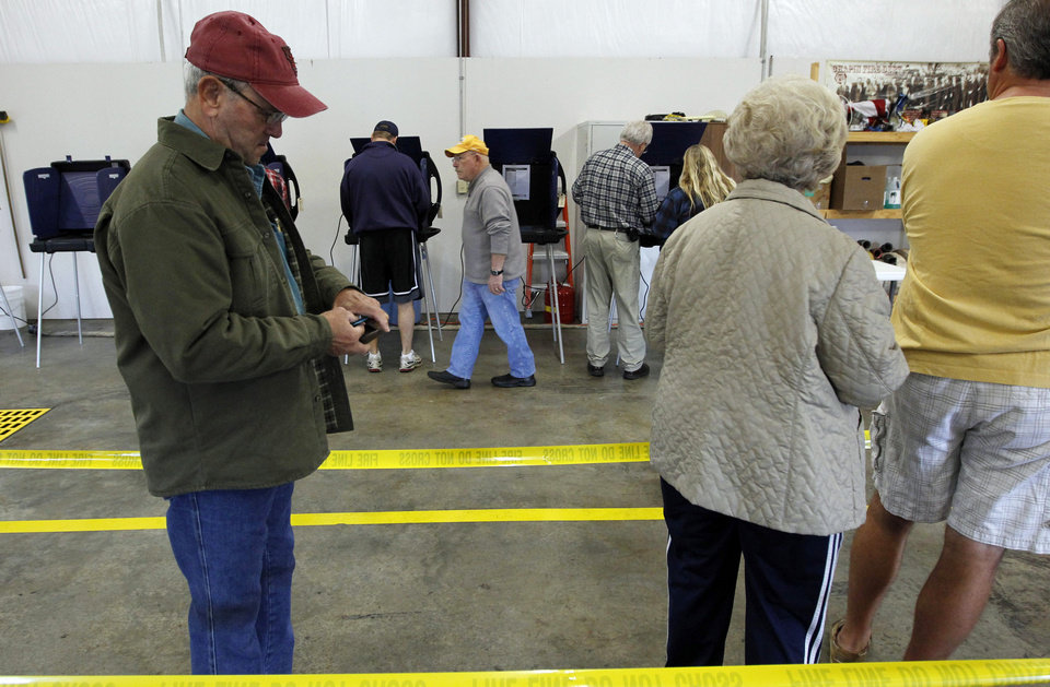 Photo - South Carolina voters wait in line to vote in the South Carolina Republican presidential primary at the Amicks Ferry Fire Station in Chapin, S.C., Saturday, Jan., 21, 2012. (AP Photo/Pablo Martinez Monsivais) ORG XMIT: SCPM101