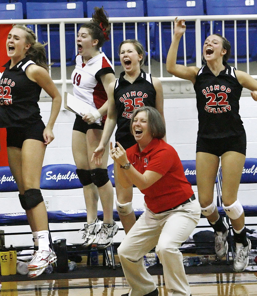 Photo - Coach Jerri Wadsworth and members of the Bishop Kelly team react to winning the State Championship at the 5A State Volleyball Championship Final held in Sapulpa Saturday. Photo by the Tulsa World