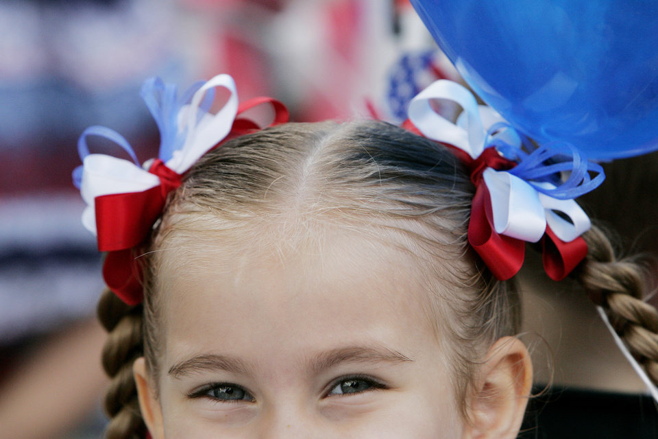 ,Wearing her red white and blue ribbons Jocelyn Kent, 5, waits for the start of the Brookhaven 4th of July parade, Saturday, July 4, 2009, in Norman. Photo by Jaconna Aguirre, The Oklahoman.
