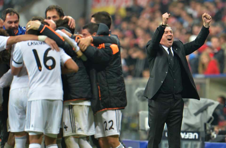 Photo - Real's coach Carlo Ancelotti celebrates after winning the Champions League semifinal second leg soccer match between Bayern Munich and Real Madrid at the Allianz Arena in Munich, southern Germany, Tuesday, April 29, 2014. (AP Photo/Kerstin Joensson)