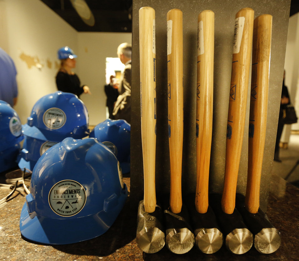 Photo - Hard hats and hammers used during a wall breaking ceremony at the Oklahoma City National Memorial & Museum in Oklahoma City, Wednesday January 8, 2014. Photo By Steve Gooch, The Oklahoman