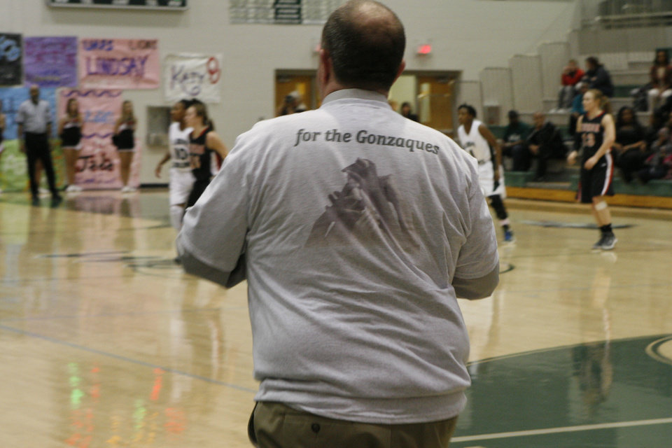 Edmond Santa Fe girls basketball coach Paul Bass wears a T-shirt in honor of the family of senior Daisha Gonzaque, whose father died Monday. PHOTO BY JASON KERSEY, THE OKLAHOMAN
