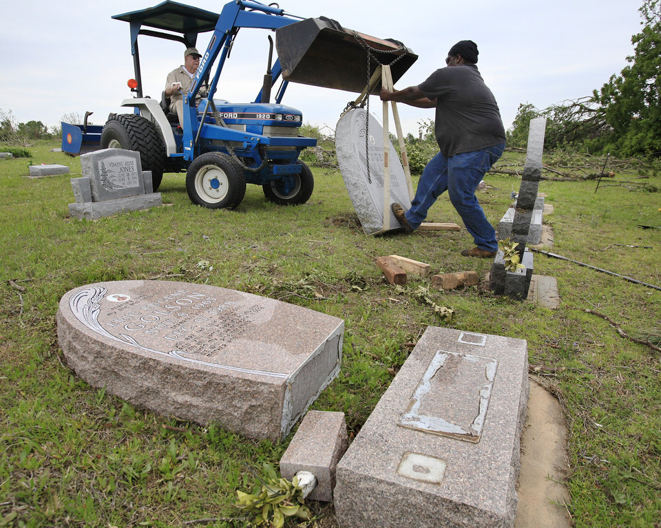 Photo - TORNADO / STORM / DAMAGE / AFTERMATH / RECOVERY: Workers use a front-end loader to upright a headstone toppled from its grave by Monday night's tornado in Earlsboro Cemetery on State  Highway 9A in  Pottawatomie County.   Many headstones in the cemetery were knocked over when the twister crossed through the area.  Photo taken Wednesday, May 12, 2010. Photo by Jim Beckel, The Oklahoman ORG XMIT: KOD