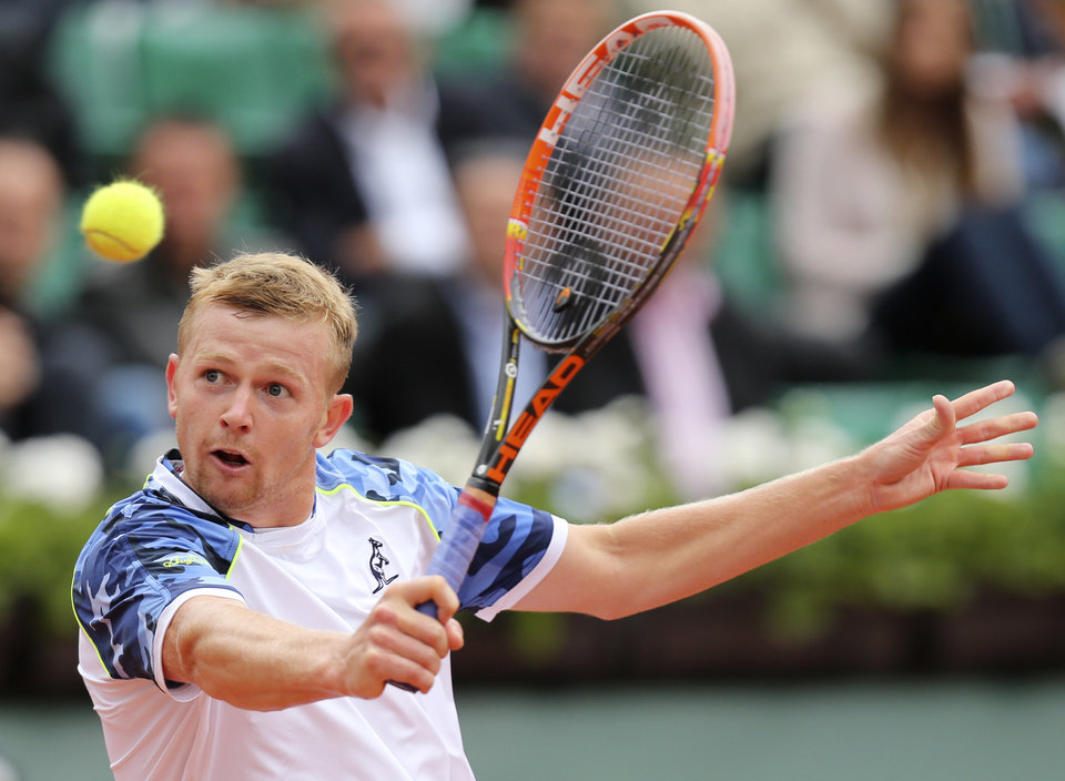 Photo - Kazakhstan's Andrey Golubev returns the ball to Britain's Andy Murray during the first round match of  the French Open tennis tournament at the Roland Garros stadium, in Paris, France, Tuesday, May 27, 2014. (AP Photo/David Vincent)
