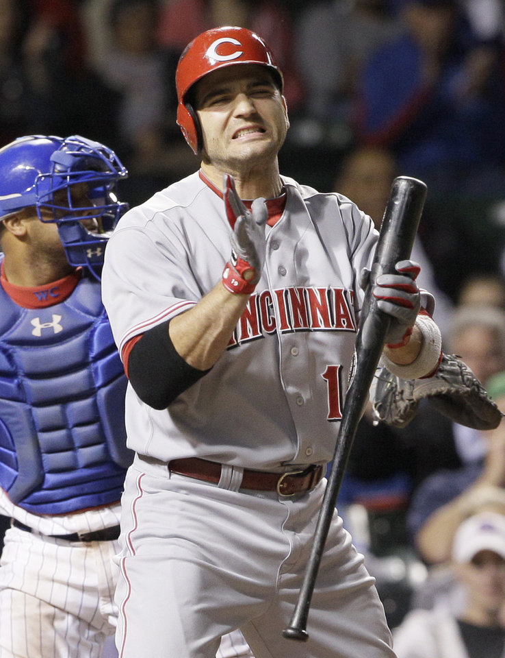 Photo -   Cincinnati Reds' Joey Votto reacts after striking out during the ninth inning of a baseball game against the Chicago Cubs in Chicago, Wednesday, Sept. 19, 2012. (AP Photo/Nam Y. Huh)