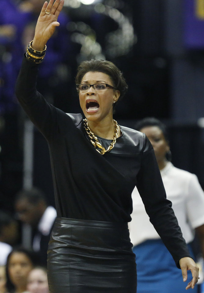 Photo - LSU basketball coach Nikki Caldwell signals her team in the second half of an NCAA college basketball first-round tournament game against Georgia Tech, Sunday, March 23, 2014, in Baton Rouge, La. LSU won 98-78. (AP Photo/Rogelio V. Solis)