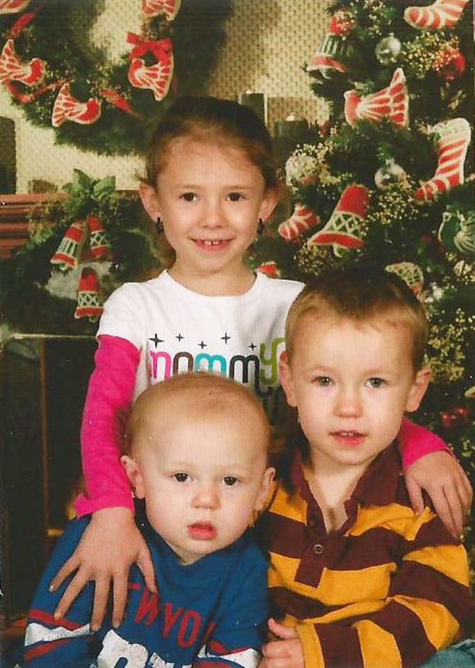 Photo - Above: Siblings Destiny Brown-Jones, John Brown-Jones II and Dylan Terry in 2010. The two boys died in a Midwest City apartment fire.