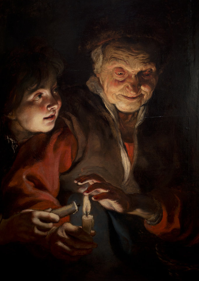 Photo - This reproduction shows a part of Peter Paul Rubens' Old Woman and Boy with  Candles (painted approximately 1616-1617) at the renovated Mauritshuis museum during a preview for the press in The Hague, Netherlands, Friday, June 20, 2014. The Mauritshuis reopens after a two-year renovation that allowed its masterpieces, including Vermeer's The Girl with the Pearl Earring to be seen by record-setting crowds abroad. The public will have access for free from 8 pm till midnight on Friday June 27th after the official ceremonial opening and from June 28 onwards the museum will revert to regular opening hours. (AP Photo/Peter Dejong)