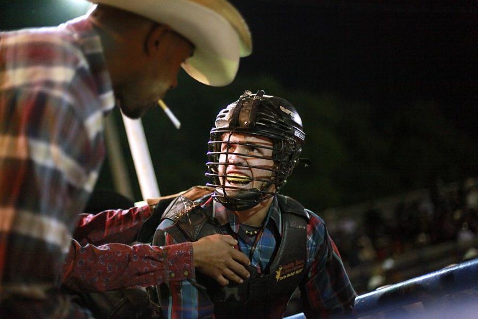 Jake Nelson gives the signal to release the gate and start his ride during the bull riding event at the Annual Spring Jam Spencer Rodeo in Spencer, Oklahoma on Saturday, May 14, 2011. Photo by John Clanton, The Oklahoman