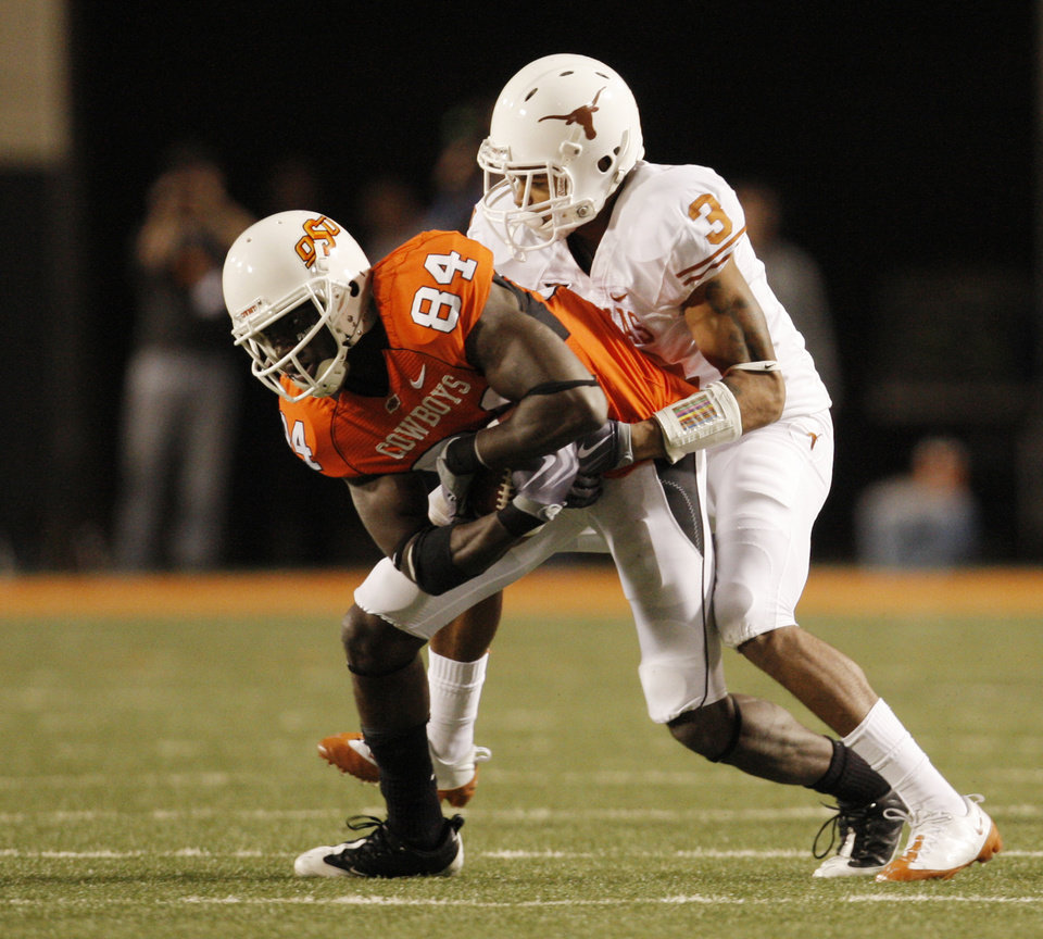 Photo - Texas' Garrett Gilbert wraps up Hubert Anyiam after a catch during OSU's 41-14 loss to Texas. Photo by Nate Billings, The Oklahoman ORG XMIT: KOD