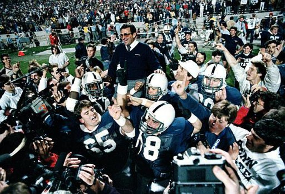 Photo - Penn State coach Joe Paterno is carried on the shoulder of his Nittany Lions players after they beat Miami, 14-10, in the Fiesta Bowl in Tempe, Ariz., Friday, Jan. 2, 1987.   (AP Photo/Jim Gerberich)