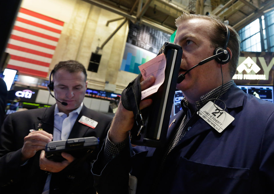 Photo - Traders Jonathan Corpina, left, and James Doherty work on the floor of the New York Stock Exchange Friday, May 30, 2014. Two negative reports on U.S. consumers were pushing stocks lower in early trading Friday. (AP Photo/Richard Drew)