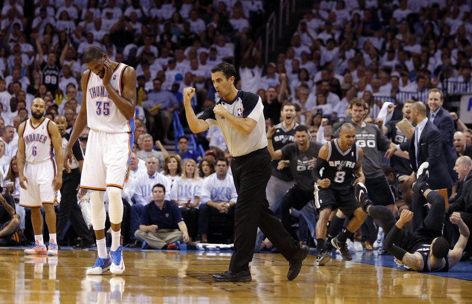 Photo - The Spurs bench celebrates as referee Zach Zarba calls Oklahoma City's Kevin Durant (35) for a foul on the 3-point shot of  San Antonio's Danny Green (4) during Game 6 of the Western Conference Finals in the NBA playoffs between the Oklahoma City Thunder and the San Antonio Spurs at Chesapeake Energy Arena in Oklahoma City, Saturday, May 31, 2014. Photo by Bryan Terry, The Oklahoman