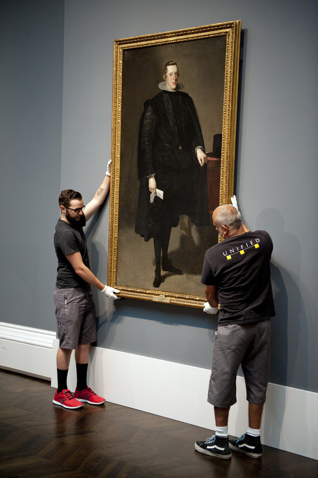 Photo -   This handout photo courtesy of the Meadows Museum shows workers installing a full-length portrait of Spain's King Philip IV at the Meadows Museum on the campus of Southern Methodist University in Dallas, on Thursday, Sept. 13, 2012. The painting is on loan from Spain's Prado for an exhibit at the Meadows opening Sunday. The exhibit is part of a partnership between the Meadows and Madrid's famed Prado. (AP Photo/Meadows Museum, Hillsman S. Jackson)