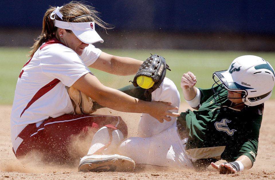Oklahoma's Georgia Casey tags out South Florida's Laura Fountain at second base in the fifth inning of a Women's College World Series game at ASA Hall of Fame Stadium in Oklahoma City, Thursday, May 31, 2012.  Photo by Bryan Terry, The Oklahoman