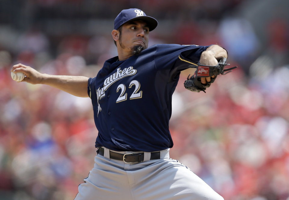 Photo - Milwaukee Brewers starting pitcher Matt Garza throws during the first inning of a baseball game against the St. Louis Cardinals Sunday, Aug. 3, 2014, in St. Louis. (AP Photo/Jeff Roberson)