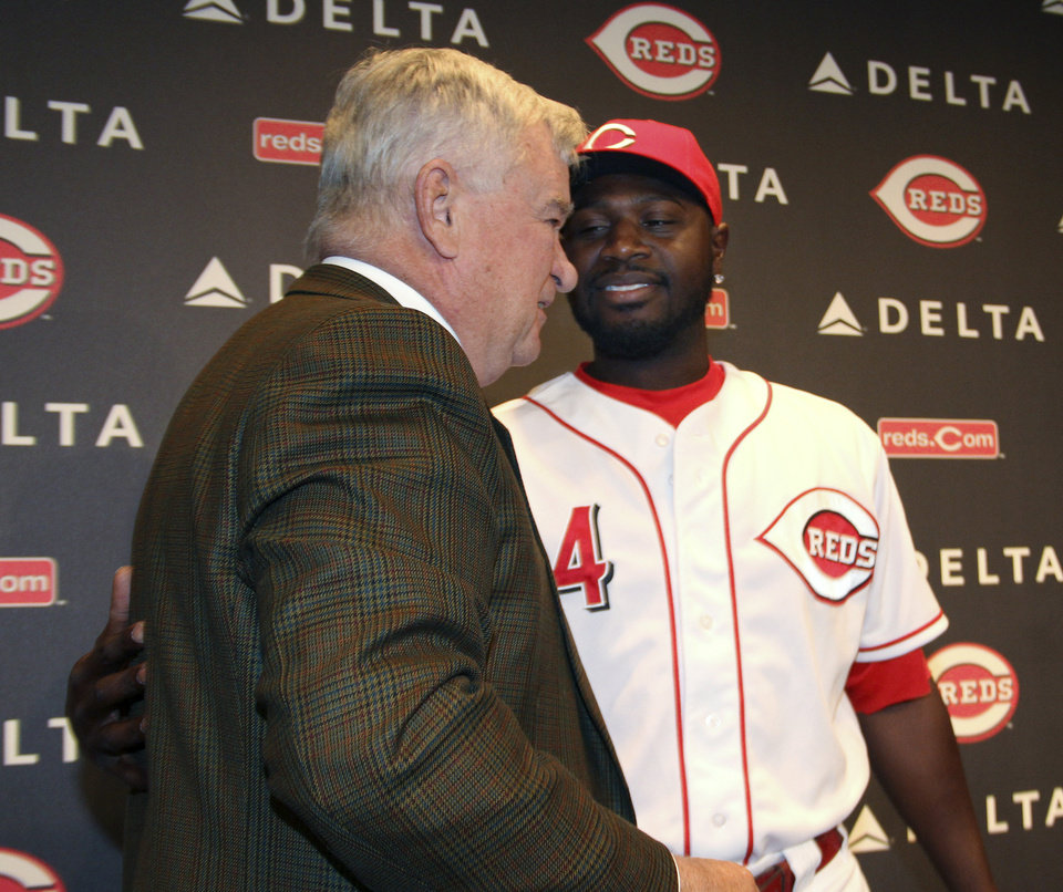 Cincinnati Reds\' Brandon Phillips hugs Reds owner Bob Castellini in Cincinnati on Tuesday, April 10, 2012. Phillips agreed to a new contract on Tuesday that will keep him with the Reds through the 2017 season. (AP Photo/Tom Uhlman)