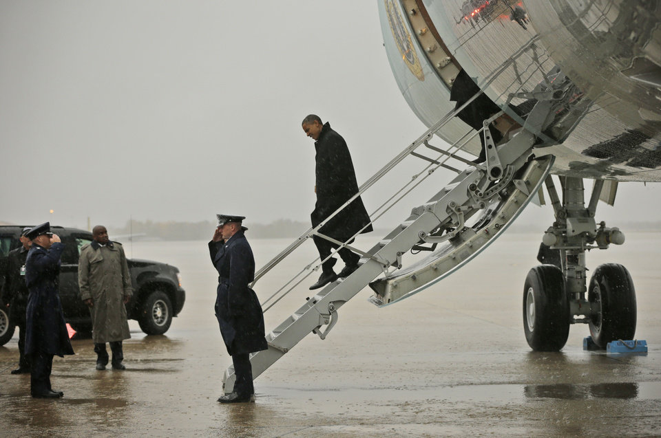 Photo -   President Barack Obama steps off Air Force One upon his arrival at Andrews Air Force Base, Md., Monday, Oct. 29, 2012. The president flew back from Florida after canceling a morning campaign rally in Orlando to return to Washington to monitor the preparation for early response to Hurricane Sandy. (AP Photo/Pablo Martinez Monsivais)