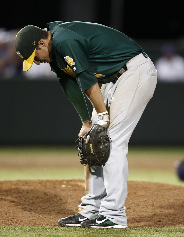 Photo - Siena's Vincent Citro reacts following his team's loss on a game-winning hit by TCU's Boomer White during an NCAA college baseball regional tournament game in Fort Worth, Texas, Friday, May 30, 2014. TCU won in eleven innings 2-1. (AP Photo/Jim Cowsert)