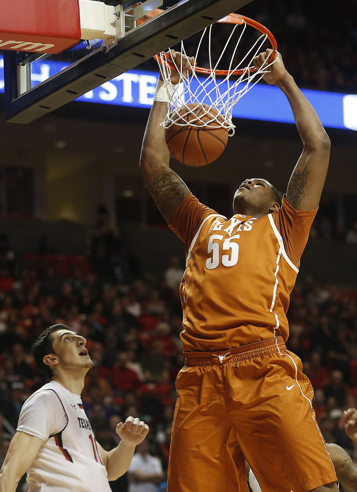 Photo - Texas' Cameron Ridley dunks over Texas Tech's Dejan Kravic during their NCAA college basketball game in Lubbock, Texas, Saturday, Mar, 8, 2014. (AP Photo/Lubbock Avalanche-Journal, Zach Long) ALL LOCAL TV OUT