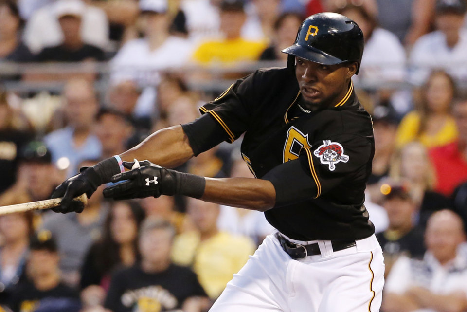 Photo - Pittsburgh Pirates' Gregory Polanco drives in two runs with a single off Miami Marlins starting pitcher Brian Flynn during the fourth inning of a baseball game in Pittsburgh Thursday, Aug. 7, 2014. (AP Photo/Gene J. Puskar)
