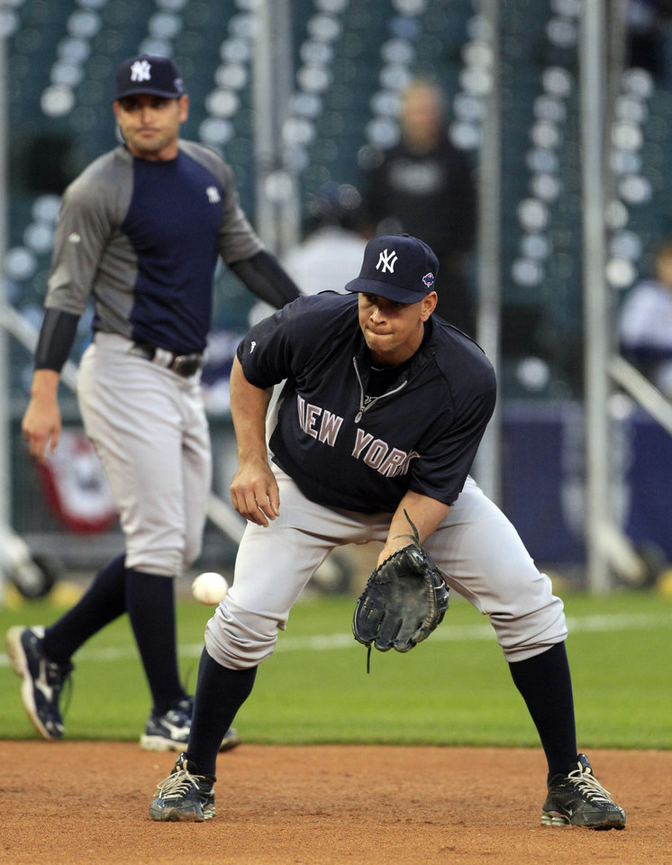 Photo -   New York Yankees' Alex Rodriguez takes fielding practice before Game 4 of the American League championship series against the Detroit Tigers Wednesday, Oct. 17, 2012, in Detroit. (AP Photo/Carlos Osorio)