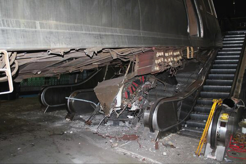 Photo - This photo released Tuesday, March 25, 2014, by the National Transportation Safety Board shows the aftermath of a Chicago commuter train that crashed Monday at O'Hare International Airport when the train jumped off the tracks and climbed an escalator. An NTSB official said Wednesday that the operator of the train admitted she