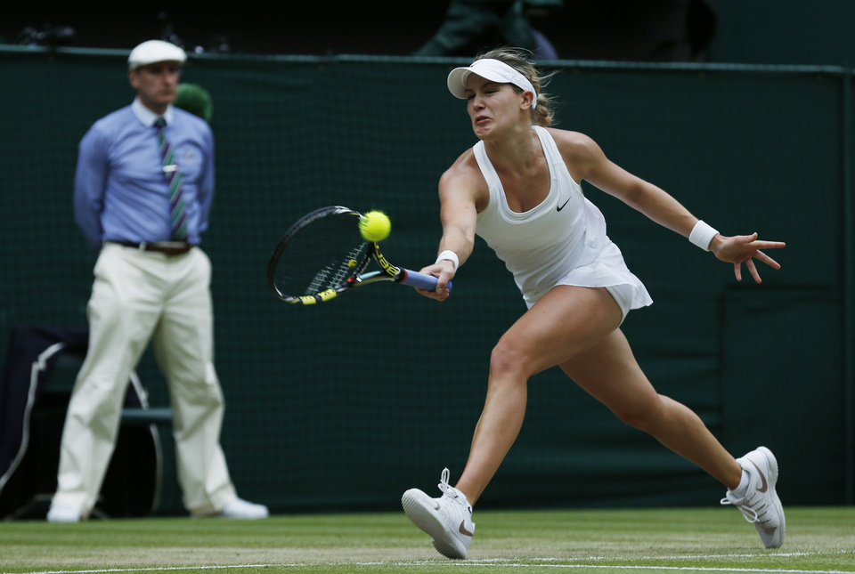 Photo - Canada's Eugenie Bouchard plays a return to Petra Kvitova of the Czech Republic during their women's singles final match at the All England Lawn Tennis Championships in Wimbledon, London, Saturday, July 5, 2014. (AP Photo/Sang Tan)