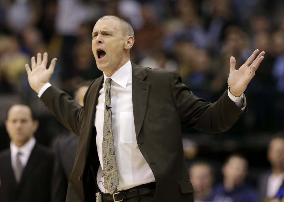 Photo - Rick Carlisle shouts at officials after his team was charged with a foul in the second half of an NBA basketball game against the San Antonio Spurs, Friday, Jan. 25, 2013, in Dallas. The Spurs won 113-107. (AP Photo/Tony Gutierrez)