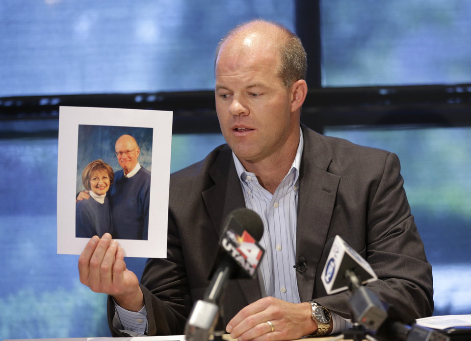 Photo - Attorney Paxton Guymon holds a photograph of Jim and Jan Harding during a news conference in Salt Lake City on Thursday, Aug. 14, 2014. Jan Harding, 67, is in critical condition at a Salt Lake City hospital's burn unit, unable to talk and fighting for her life, Guymon said. She drank sweet tea containing a toxic cleaning chemical, severely burning her mouth and throat at a Utah restaurant after an employee mistook the substance for sugar and mixed it into a dispenser, Guymon said. (AP Photo/Rick Bowmer) (AP Photo/Rick Bowmer)