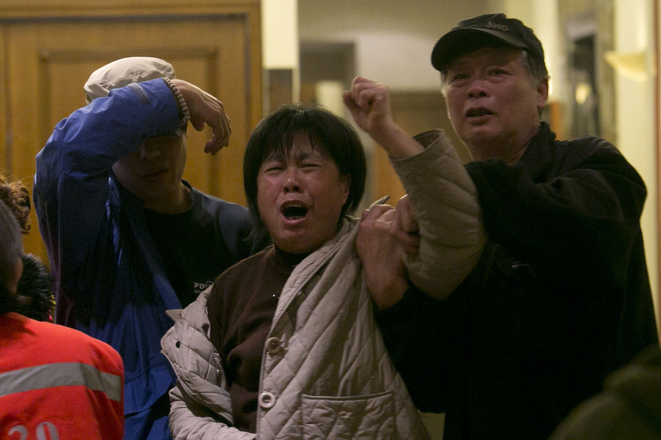 Photo - A relative of one of the Chinese passengers aboard the Malaysia Airlines, MH370 grieves after being told of the latest news in Beijing, China, Monday, March 24, 2014. A new analysis of satellite data indicates the missing Malaysia Airlines plane crashed into a remote corner of the Indian Ocean, Malaysian Prime Minister Najib Razak said Monday. Malaysia Airlines said in a statement to the families that