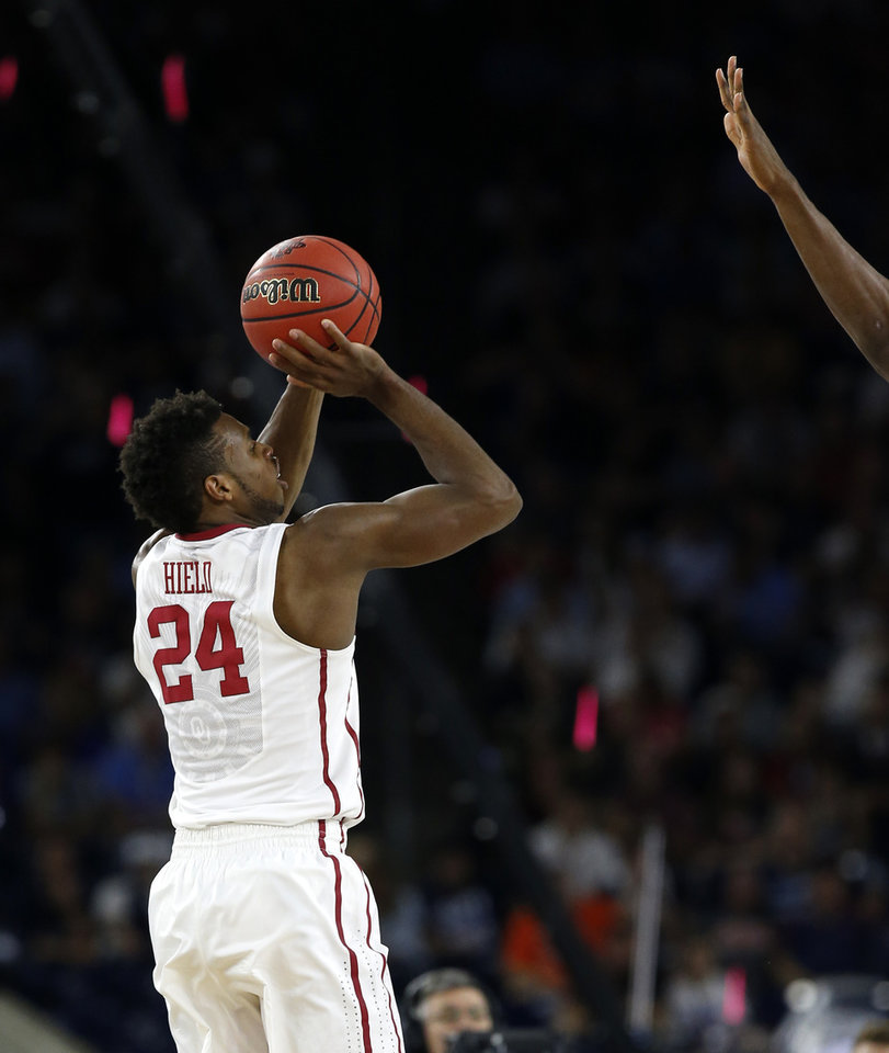 Photo - Oklahoma's Buddy Hield (24) shoots a basket during the national semifinal between the Oklahoma Sooners (OU) and the Villanova Wildcats in the Final Four of the NCAA Men's Basketball Championship at NRG Stadium in Houston, Saturday, April 2, 2016. Photo by Nate Billings, The Oklahoman