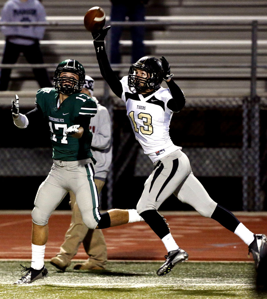 Photo - Broken Arrow's Gabe Johnson (13) deflects a pass intended for Norman North's Channing Meyer in class 6A football on Friday, Nov. 16, 2012 in Norman, Okla.  Photo by Steve Sisney, The Oklahoman