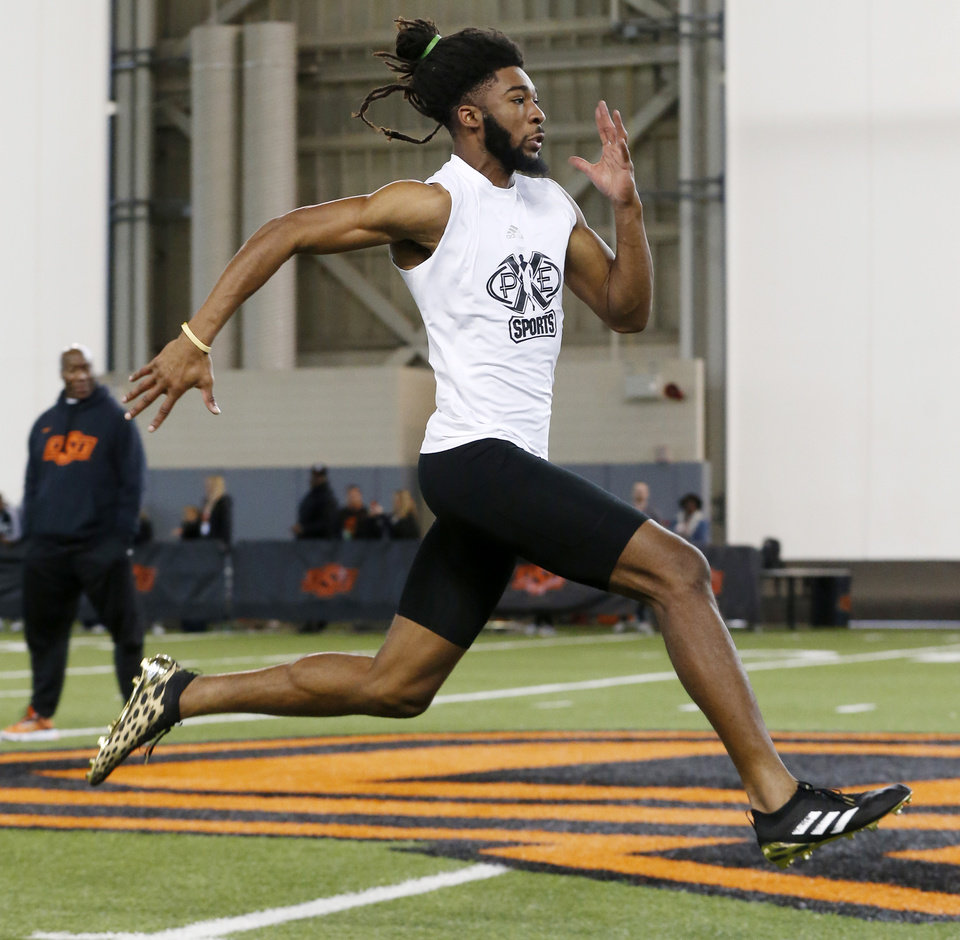 Photo - Oklahoma State receiver Jordan McCray runs the 40-yard dash during OSU Pro Day inside the Sherman E. Smith Training Center in Stillwater, Okla., Tuesday, March 10, 2020. [Nate Billings/The Oklahoman]