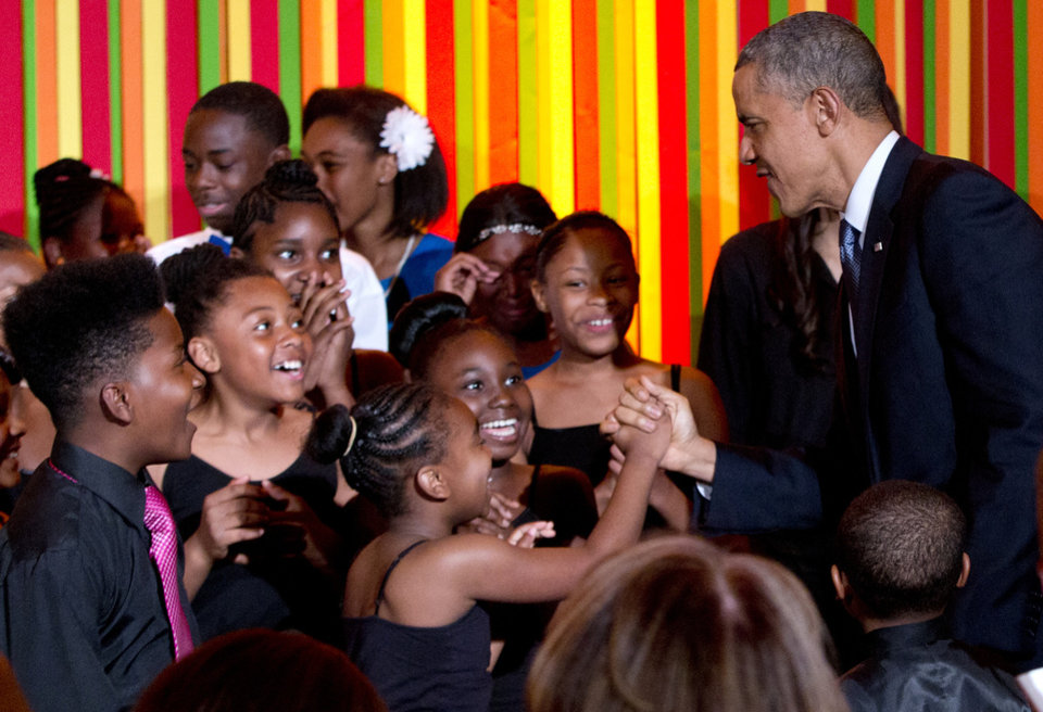 Photo - President Barack Obama greets student performers on stage during the White House Talent Show, in the East Room of the White House, in Washington, Tuesday, May 20, 2014. The White House Talent Show was hosted by first lady Michelle Obama and the President's Committee on the Arts and the Humanities (PCAH). (AP Photo/Carolyn Kaster)
