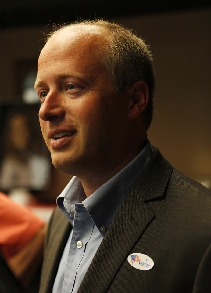 Photo - Brian Maughan during a watch party for Brian Maughan, incumbent candidate for county commissioner, Tuesday, June 26, 2012.  Photo by Garett Fisbeck, The Oklahoman