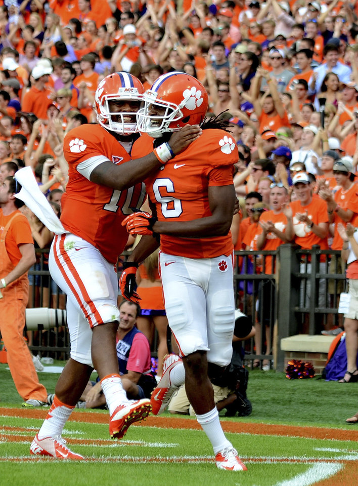 Clemson quarterback Tajh Boyd (10) celebrates DeAndre Hopkins' second-quarter touchdown reception during an NCAA college football game against Georgia Tech on Saturday, Oct. 6, 2012, at Memorial Stadium in Clemson, S.C. (AP Photo/ Richard Shiro)