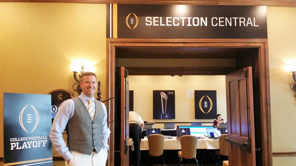 Photo -  Oklahoma native Jason W. Taylor is a college football diehard. An unexpected email led to the software developer's company being selected to build a system for the College Football Playoff. Earlier this year, he visited