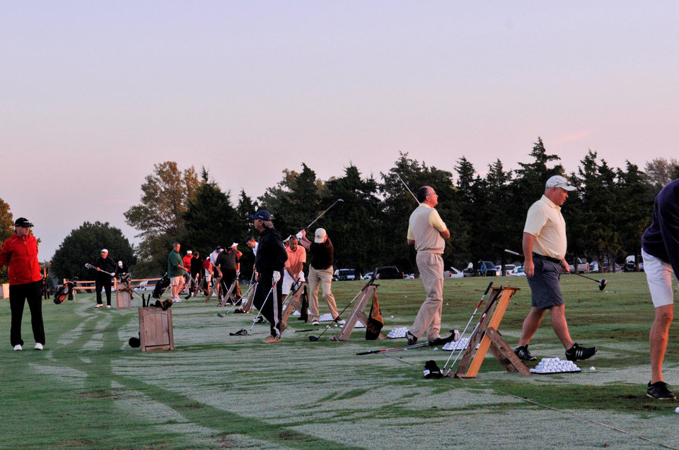 Photo - Golfers warm up for the golf tourney. PHOTO PROVIDED