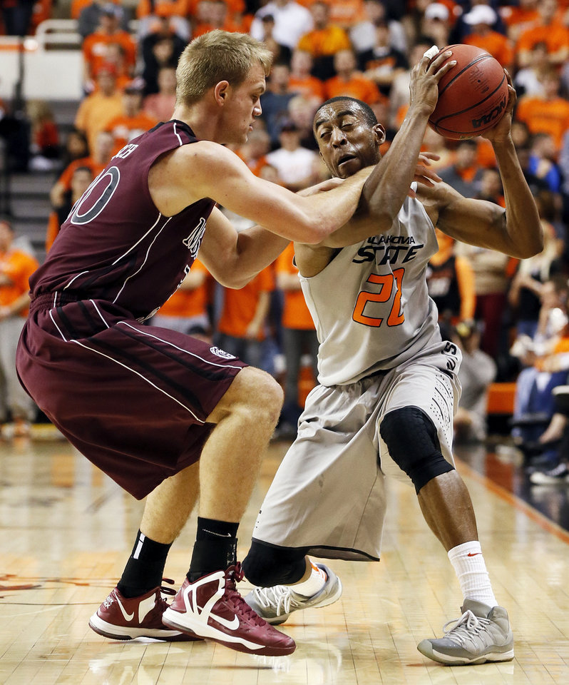 Photo - Missouri State's Nathan Scheer (30) defends OSU's Markel Brown (22) during a men's college basketball between Oklahoma State University and Missouri State at Gallagher-Iba Arena in Stillwater, Okla., Saturday, Dec. 8, 2012. Photo by Nate Billings, The Oklahoman