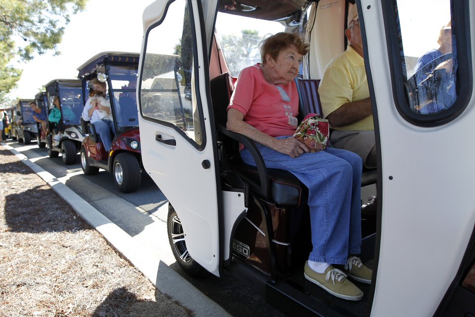 Photo -   Residents arrive in golf carts for a campaign event by Republican presidential candidate, former House Speaker Newt Gingrich, at the The Villages, Sunday, Jan. 29, 2012, in Lady Lake, Fla. (AP Photo/Matt Rourke)