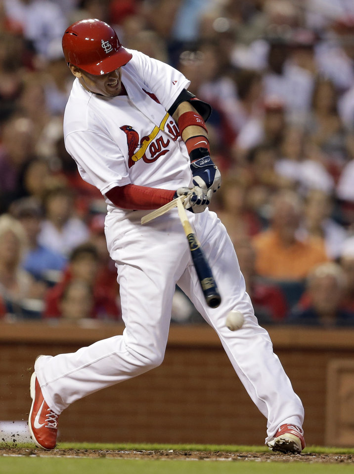Photo - St. Louis Cardinals' Allen Craig breaks his bat during the third inning of a baseball game against the New York Yankees on Tuesday, May 27, 2014, in St. Louis. Craig reached on an error by Yankees first baseman Kelly Johnson, allowing Matt Holliday to score. (AP Photo/Jeff Roberson)