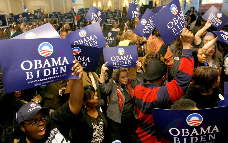 Photo - Obama supporters celebrate during the Democratic watch party for the presidential election in Oklahoma City, Tuesday, November 4, 2008. BY BRYAN TERRY, THE OKLAHOMAN
