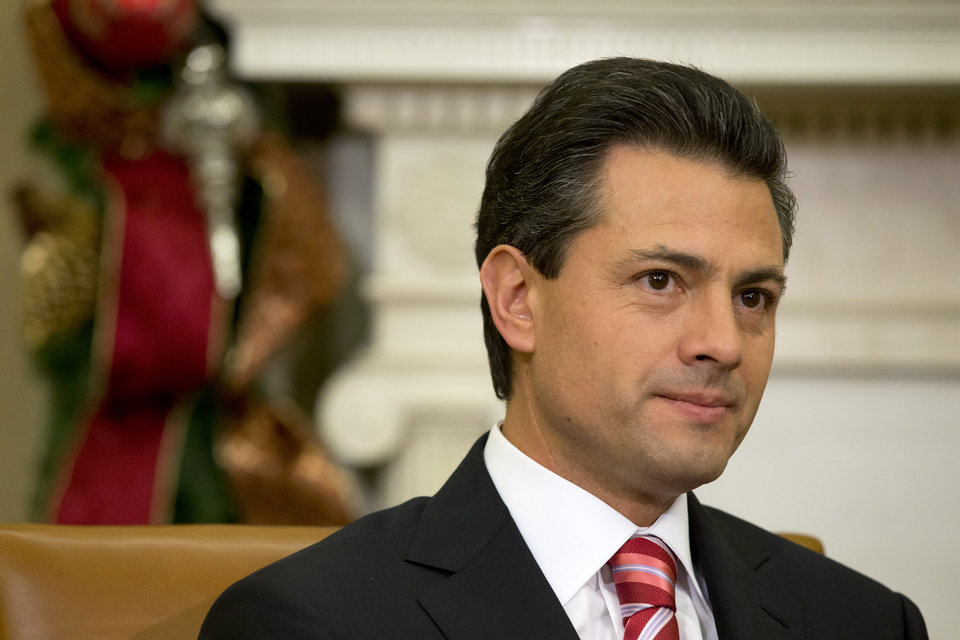 Mexico's President-elect Enrique Pena Nieto listens as President Barack Obama speaks prior to their meeting in the Oval Office of the White House in Washington, Tuesday, Nov. 27, 2012. (AP Photo/Jacquelyn Martin)