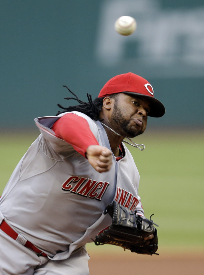 Photo - Cincinnati Reds starting pitcher Johnny Cueto delivers against the Cleveland Indians in the first inning of a baseball game Tuesday, Aug. 5, 2014, in Cleveland. (AP Photo/Mark Duncan)